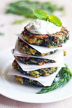 Zucchini, Feta, and Spinach Fritters with Garlic Tzatziki by hostthetoast:  Great for appetizers or a light snack, and a fantastic way to sneak in some veggies. #Fritters #Zucchini #Feta #Spinach #Healthy #Veggie