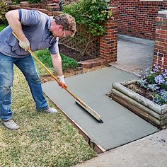 This how-to video shows step-by-step instructions (and provides a shopping list) for pouring and finishing a concrete sidewalk, like the home entry, shown here. Save the pin, and click the link to see more! Diy Concrete Slab, Pavers Over Concrete, Pouring Concrete Slab, How To Lay Concrete, Poured Concrete Patio, Cement Patio, Concrete Steps, Concrete Crafts, Concrete Projects