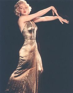 'The Gold Dress' by Travilla, worn by Marilyn Monroe in 'Gentlemen Prefer Blondes', 1953.  Pleated gold lame halterneck. So revealing that it could only be worn briefly in the film to pass the censors.