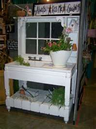 love the old sink in this plant stand.