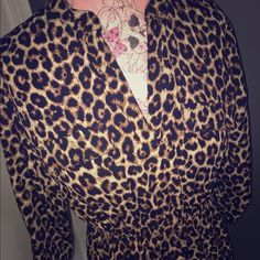Rue 21 Leopard Long shirt/short dress Love this so much!! Just doesn't fit :( sz m Rue 21 leopard shirt. Could be worn as a very short mini dress too. Gold button accent. NWT Rue 21 Tops Blouses