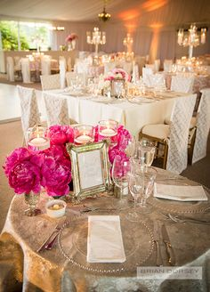 Arrangements of hot pink peonies in mercury glass vessels sat atop a metallic linen to complete the modern-vintage feel. Check out the full beautiful wedding.