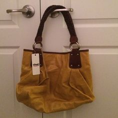 NWT Tano The Romantic Tote in Mineral Yellow NWT Tano The Romantic Handbag in Mineral Yellow. Dark brown braided straps, genuine yellow leather bag with a fun purple interior. Zip pocket and cell phone compartment. Gold hardware. Tano Bags Totes