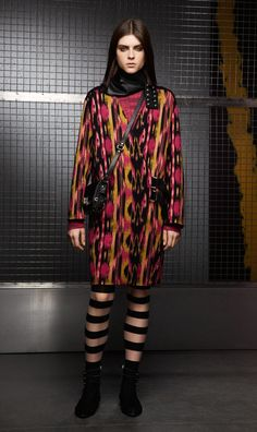 PINK IKAT BUCKLE COAT Wear the style of the future an oversized coat with an energetic, almost fluorescent print recalling the digital age. Details are essential and the glam rock shoulder bag, ankle boots and leather scarf add the perfect touch.