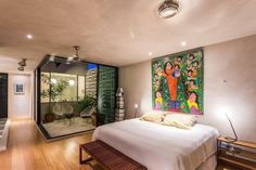 Two-Story Glass Wall Makes Narrow Mexican Home Feel Huge