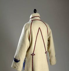 Paul Poiret Overcoat - Paris 1923. White wool, wi/ patch pockets of blue felt trimmed w/ red and silver leather and flowers. Chicago History Museum