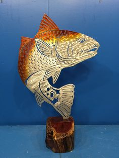 This is an Oscar for best catch! https://themetaledge.com/trophies/colored-powder-coat/redfish-with-scales-standing-mount-powdercoat.html