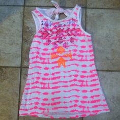 Summer tank top Really cute vibrant summer tank top. It has a cut out design in the back along with a pink tye-dye stripped design all over. Size 14 girls from Jcpenny's Arizona Jean Company line. In GREAT condition, never worn. Feel free to ask any questions! Arizona Jean Company Tops Tank Tops