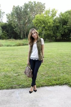olive vest over lace top and jeans