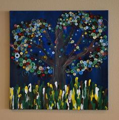 """The Giving Tree: This wonderful wall hanging is a spectacular effort of art and whimsy set among beautifully hand laid buttons, quill work and finger paint. Each student hand laid every single button and quilled each accent. The """"grass"""" is every student and their teachers' own unique finger print! Priceless and wonderful, the buttons are in the shape of a heart, reminding you that your children's love of learning is never ending"""