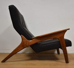 This 990-LC lounge chair was designed by Adrian Pearsall for Craft Associates has been reupholstered in soft black leather and the walnut frame has been professionally refinished. Seat height is 15 30 wide. 44 deep. 33 tall.