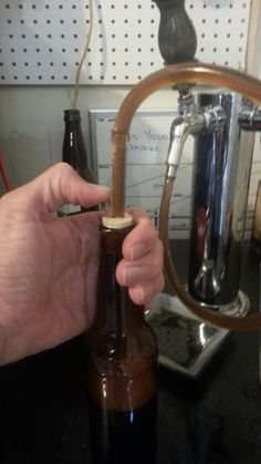 Bottle Your Homebrew the Easy Way · Cheap counter pressure filler.