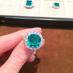 An emerald and diamond ring by Bayco