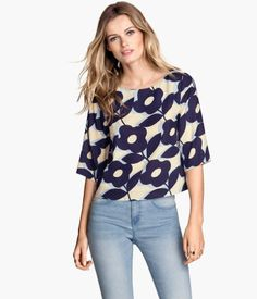 Size 12 Blouse in woven fabric with a printed floral pattern and 3/4-length sleeves. mine is black white and blue. slightly different pattern.  DETAILS 100% viscose. Iron when damp. Machine wash cold Imported Art.No. 47-8366