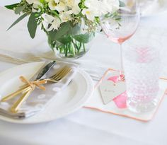 Regardless of your relationship status, Valentine's Day is a great time to put on your hostess hat and practice entertaining in style. A simple and affordable yet elegant fete can be assembled in no time with an easy menu and welcoming decor. Just follow these basic guidelines for throwing a little Valentine's Day soiree for friends or that special someone. Short on space or don't have a dining table? Use my favorite trick and turn the coffee table into a romantic table for two.