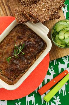 "Home-made ""leverpostej"" or also known as a paté served with a cucumber salad or preserved beetroots and rye bread"