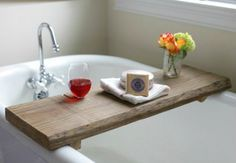 Make this simple rustic bath caddy, which has a wine glass holder, to relax with from a single board of reclaimed wood.