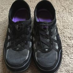 Skechers Shoes Sketchers slide ons with memory foam. Black and silver with purple logo and inside. Barely worn, so great condition with no flaws. Skechers Shoes Sneakers