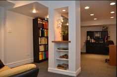 Hide a basement pole with a bookcase
