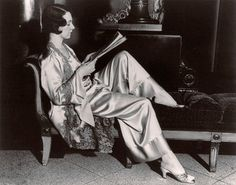 Model wearing lounging pyjamas made of radium figured silk. c.1925