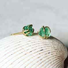 """""""Green is the prime color of the world and that from which its loveliness arises."""" Pedro Calderon de la Barca  Cage set raw emerald crystal stud earrings in yellow gold. Stand 105 Soane Hall #madelondon  http://ift.tt/2dxVMuV @tuttonandyoung  #wordsandjewels #weddingwednesday #tamaragomezjewellery #rawluxury #spiritinspired #rawbeauty #rawemeralds  #craftanddesign #londondesign #roughluxe #boholuxe #artisanjewellery #artisanjewelry #girlboss #instastyle #goldsmith #cockpitarts #studiolife…"""