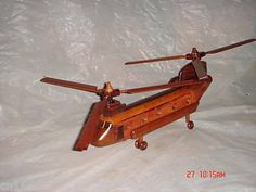"""Chinook Hand Craft Wooden Model Helicopter Require Couple Simple Assembly by minh xuan. $39.99. This high quality souvenir models are built from mahogany wood, hand craft stain and finish with clear gloss.    the CHINOOK Helicopter measure approximately 13"""" long, 6"""" height from the bottom of the stand to the tallest point of the helicopter, 2-1/2"""" body width, and each rotor diameter is 14"""". this model helicopter requires couple easy assembly for safe in transportation. Chinook Helicopters, Radio Control, Couple, Handmade, Craft, Transportation, Hobbies, Models, Amazon"""