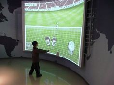 At a Technology Museum in Europe: TouchMagix Interactive Wall running on a curved projection surface. People enjoy racing the car to run on renewable energy and by dodging the footballs to save goals.  http://blog.touchmagix.com/technology-museum-europe-interactive-wall-projection-system.html