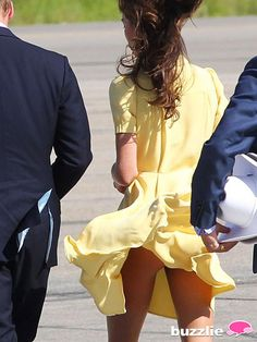 Yellow Flyaway, 2012 - Despite being happily married to Wills,Kate refuses to leave her life as a young, modern girl behind That means she has to always be on the watch for a royal fashion blunder! Middleton loves her short, flowing dresses like this one by Jenny Packham, but the light material is always getting caught up in the wind. Onlookers got a bit of a peep show, but she played it off like a coy young lady.