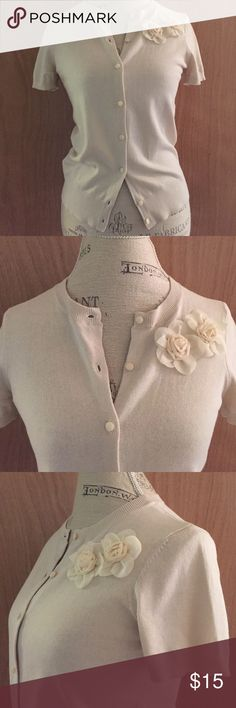 Ann Taylor LOFT cardigan Ann Taylor LOFT short sleeved button down cardigan in a light beige/cream color with pretty flower accents.  In excellent like new condition.  Size SP LOFT Sweaters Cardigans