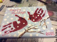 Handprint cardinals on canvas