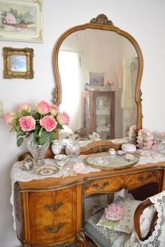 Antique dressing table with lace and roses. Feminine and pretty!