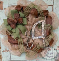 This gorgeous wreath is made with a burlap deco mesh that resembles burlap but holds its shape very well. Please include your letter choice in
