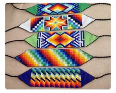 Beaded bracelets with vibrant colours and characteristics of the Colombian Embera Chami Tribe. Bead Loom Patterns, Jewelry Patterns, Beading Patterns, Bracelet Patterns, Native American Patterns, Native American Beading, Native Indian Jewelry, Nativity Crafts, Native Beadwork