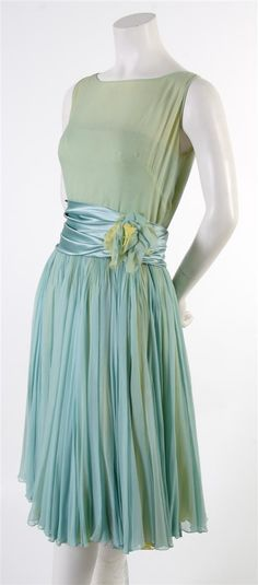 A Harvey Berin Green and Blue Chiffon Cocktail Dress, 1950s, with a satin sash at waist with floral applique, full skirt. Labeled: Harvey ...