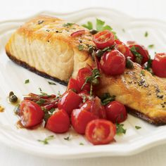 Grape tomatoes sautéed with capers, shallot and cumin form a bright, chunky sauce for seared salmon. The recipe is from Ted Allen's cookbook, The Food You Want to Eat. More Fast Fish Recipes