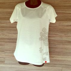 The North Face white design tee Perfect condition. NWOT. Authentic. Women's sizing. 100% polyester. The North Face Tops Tees - Short Sleeve