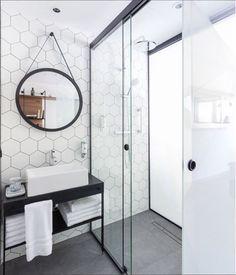 A honeycomb backsplash tile. Black and white bathroom decor House Bathroom, Bathroom Renos, Modern Bathroom Design, Honeycomb Backsplash, Round Mirror Bathroom, Bathrooms Remodel, Beautiful Bathrooms, Bathroom Inspiration, Tile Bathroom