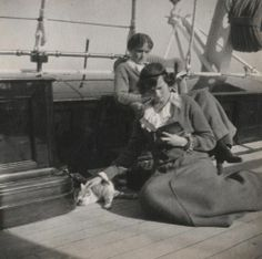 Grand Duchesses Olga and Tatiana with a pet cat reading aboard the Standart