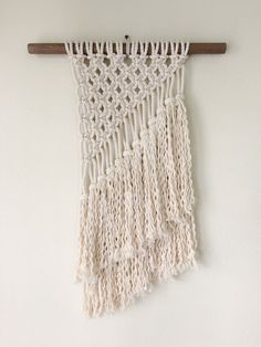 """Inspired by where the sky meets the land, this beautiful Macrame Wall Hanging will add that needed dimension to any wall.Dowel width: 16.5"""" Macrame width: 10"""" Length: 22""""..."""