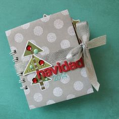 Red and green stickers and embellishments pop on a neutral mini album for this sweet December Daily album.