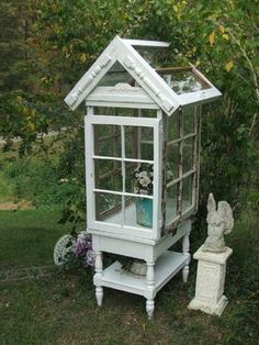 Conservatory for starting plants. I saw a similar one at an old house today. Cool.
