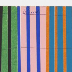 Pattern of repeating black, green, blue, pink, orange, blue, red and brown repeating thin, vertical stripes of pasted colored paper.