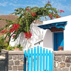 Blue and white with a splash of red and green - the classic colours of Greece. Santorini is full of pretty little houses but this one near the ruins of Akrotiri (Santorini's own version of Pompeii) was one of my favourites with that bougainvillea hanging over it and that cute blue gate.