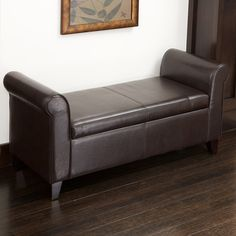 228013 - Torino Armed Storage OttomanEspresso brown leather for a modern style Padded top makes for great additional seating Sturdy wood frame Unique armed-ottoman style Hidden interior storage space  Product Dimensions: 49 x 20 x 23