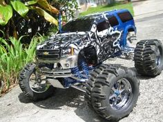 Traxxas E-Maxx RC Monster Truck with custom painted Suburban body Remote Control Boat, Radio Control, Rc Cars And Trucks, Lifted Trucks, Fancy Cars, Car Pictures, Custom Cars, Monster Trucks, Rc Vehicles