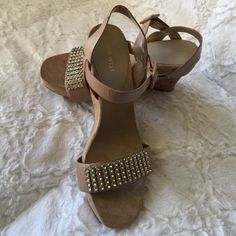 Nine West platform wedge sandals Nine West platform wedge sandals. Jeweled strap with clear gems. Suede insoles with ultra comfortable padding to make wearing these more comfortable on your feet. New never been worn. Nine West Shoes Sandals