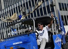 Hundreds of thousands of fans filled downtown to watch the Kansas City Royals World Series victory parade Tuesday, Nov. 3, 2015. Mike Moustakas fan Craig Rookstool, rode in the parade before the Royals third baseman.