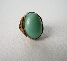 Vintage Milky Green Glass Brass Filigree Costume Ring. $22.50, via Etsy.