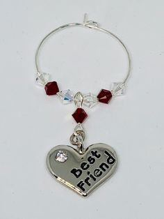 Best Friend Garnet Wine Glass Charm - set with a silver plated heart engraved with Best Friend - finished with Garnet and Clear Swarovski Crystals Garnet is the birthstone for January Friends Set, Wine Glass Charms, Swarovski Pearls, Organza Bags, Bridal Accessories, Heart Charm, Birthstones, Garnet, January
