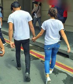 """This is Daniel Padilla and Kathryn Bernardo walking down the street and holding hands together while preparing to surprise sick children at the ABS-CBN Compound in Quezon City during the taping of the ABS-CBN 2016 Christmas Station ID, """"Isang Pamilya Tayo Ngayong Pasko."""" Indeed, KathNiel is my favourite Kapamilya love team, and they're helpful and kind. #KathrynBernardo #DanielPadilla #KathNiel #KathNielBernaDilla #ABSCBNChristmasStationID #IsangPamilyaTayo #IsangPamilyaTayoNgayongPasko"""